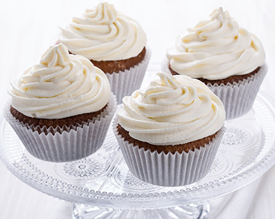 Mother's Pumpkin Cupcakes with Orange Cream Cheese Frosting